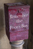 Remember the Poors Box. A Remember the Poors Box located at St. Bartholomews Hospital in London, UK.  Before the National Health Service, the sick were dependent Royalty Free Stock Image