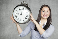 Remember about punctuality. Young very attractive girl royalty free stock image