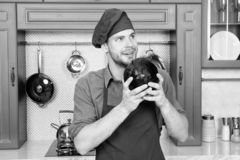 Remember recipe. Take old favorites and make healthful substitutions. Take favorite recipes and lighten them up. Man. Handsome chef holds violet cabbage stock photo