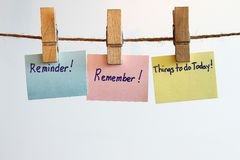 Remember reminder. Remember, reminder, and things to do today hanging in a clotheslinw concept Royalty Free Stock Image