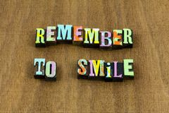 Remember smile smiling happy fun honest kind phrase. Typography letterpress kindness friendly reminder positive approach optimism love life live enjoy stock image