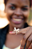 Remember that task. African American businesswoman with string tied to finger to remember important task Stock Photo