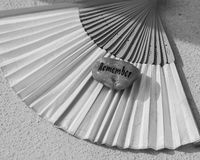 Remember. Token stone and Japanese fan Royalty Free Stock Photo