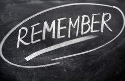 Remember word written on a blackboard Stock Image