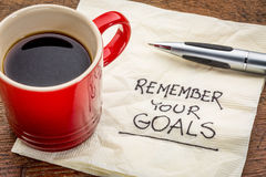 Remember your goals. Handwriting on a napkin with a cup of epsresso coffee Stock Photography