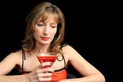 Remembering. A beautiful woman drinking a cocktail and remembering her past stock photo