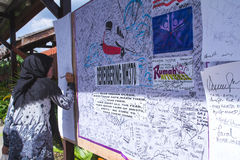Remembering  MH370. Sabah, MALAYSIA - MH370 missing plane, Malaysians showing support by writing prayers on a wall at a upside down house,Sabah Royalty Free Stock Images