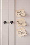 Remembering The Necessities. To Do Notes on Computer Armoire Door for miscellaneous presentations Royalty Free Stock Photos