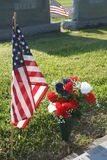 Remembrance. Flag and flowers on veteran's grave Royalty Free Stock Image