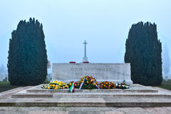Remembrance alter at Tyne Cot, Flanders Fields. Remembrance alter at Tyne Cot cemetery for the first World War on a misty day, near Ypres in Flanders Fields Royalty Free Stock Photo