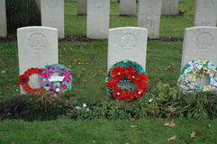 Remembrance. Of Australian soldiers with wreaths made by Australian schoolkids and ut on the graves far from their homeland in Belgium Stock Image