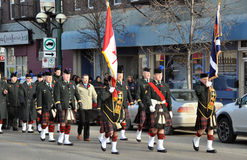 Remembrance Day parade on Tache Ave. Photo was taken during Canadian Remembrance Day ceremonies in Winnipeg City, Manitoba province, Canada. on November 11, 2013 Stock Photos
