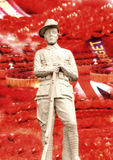 Remembrance Day. Soldier of WWI in front of red poppies background  and lest we forget banners; concept of a blood bath; tribute to loved ones and lest we forget Royalty Free Stock Images