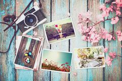 Remembrance and nostalgia of Happy easter day in spring. Photo album in remembrance and nostalgia of Happy easter day in spring on wood table. instant photo of Stock Photo