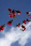 Remembrance poppies in the sky. Remembrance poppies falling in the sky Royalty Free Stock Image