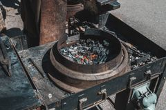 Remeslic blacksmith. coals for metal nogrev to red. have toning. close-up. Steel heat forge smithy hot forging iron flame spark equipment fire work craft flames royalty free stock photo