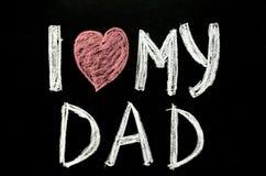 Remettez à amour du ` i des textes écrits mon ` de papa sur le tableau Images stock