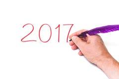 2017 Remettez à des nombres d'écriture le stylo pourpre sur le fond blanc Photographie stock libre de droits