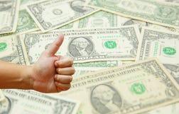 Remettez à prise le dollar US beaucoup avec le fond de billet de banque de dollar US Photos libres de droits