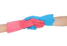 Remettez à secousse dans les gants en caoutchouc d'isolement sur le fond blanc Photo stock