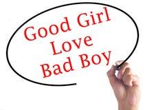 Remettez écrire à de bonnes filles l'amour de mauvais garçons sur le conseil transparent Photos stock