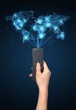 Remettez avec le concept à télécommande et social de media Image stock