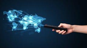 Remettez avec le concept à télécommande et social de media Image libre de droits