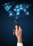 Remettez avec le concept à télécommande et social de media Photographie stock libre de droits