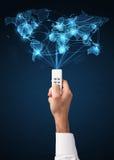 Remettez avec le concept à télécommande et social de media Photo stock