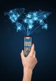 Remettez avec le concept à télécommande et social de media Images stock