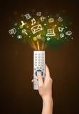 Remettez avec les icônes à télécommande et sociales de media Photographie stock libre de droits