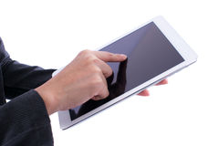 Remettez juger le comprimé de téléphone d'isolement sur le fond blanc Photo libre de droits