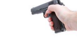 Remettez juger le pistolet de pistolet d'isolement sur le fond blanc photographie stock libre de droits