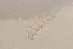 Remettez l'écriture en sable en quelques vacances d'été sur la plage Photos libres de droits