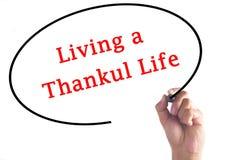 Remettez l'écriture vivant une vie reconnaissante sur le conseil transparent Photo libre de droits