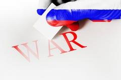 Remettez la gomme texturisée de drapeau pour effacer la guerre de mot Concept de paix Images stock
