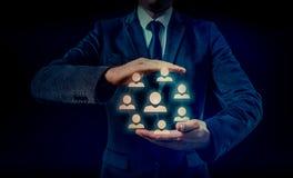 Remettez le réseau de transport d'icône d'homme d'affaires - concept d'heure, de HRM, de MLM, de travail d'équipe et de direction Photographie stock