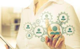 Remettez le réseau de transport d'icône d'homme d'affaires - concept d'heure, de HRM, de MLM, de travail d'équipe et de direction Images stock