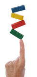 Remettez les blocs de équilibrage sur le doigt Photo libre de droits