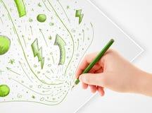 Remettez les croquis et les griffonnages abstraits de dessin sur le papier Photo stock