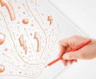 Remettez les croquis et les griffonnages abstraits de dessin sur le papier Photographie stock