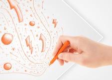 Remettez les croquis et les griffonnages abstraits de dessin sur le papier Images stock