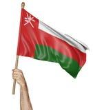 Remettez onduler fièrement le drapeau national de l'Oman illustration de vecteur