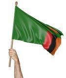 Remettez onduler fièrement le drapeau national de la Zambie Photographie stock