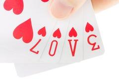 Remettez retenir des cartes de jeu orthographiant l'amour de mot Image libre de droits