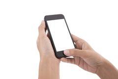 Remettez tenir le téléphone intelligent avec l'écran d'isolement sur le blanc images stock