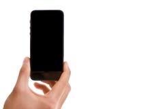 Remettez tenir le téléphone intelligent mobile avec l'écran noir d'isolement sur le fond blanc photos stock