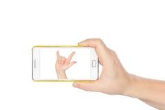 Remettez tenir Smartphone pour regarder l'amour I de main dedans Image stock