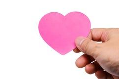 Remettez tenir un jour de valentines de coeurs d'étiquette sur le blanc Image libre de droits