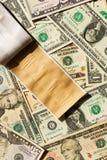 Remiendo y dólares imagen de archivo libre de regalías